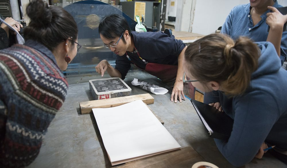 Artists look at a print